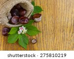 Chestnuts In Burlap On Wood...