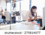 woman working at computer in an ... | Shutterstock . vector #275814077
