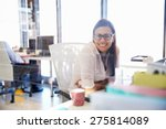 woman at her desk in an office