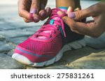 hands of a young woman lacing... | Shutterstock . vector #275831261