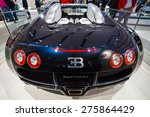 Small photo of BERLIN - MAY 02, 2015: Showroom. Supercar Bugatti Veyron EB 16.4. Fastest serial car in the world. Rear view. Produced from 2005 to 2011.