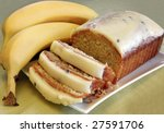 Banana cake with a cream cheese and passionfruit icing. - stock photo