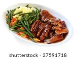 Platter of sliced roast beef with gravy, mashed potatoes, string beans and carrots.  A hearty meal. - stock photo