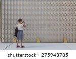 Small photo of MILAN, ITALY - MAY 6:Woman takes a pic outside Bahrain pavilion at Expo, universal exposition on the theme of food on MAY 6, 2015 in Milan.