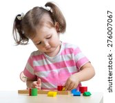 Stock photo little child girl playing with puzzle toys isolated 276007067