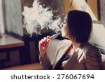 young woman smoking electronic... | Shutterstock . vector #276067694