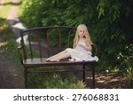 beautiful blonde girl sitting... | Shutterstock . vector #276068831