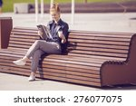 smiling woman sitting on a... | Shutterstock . vector #276077075