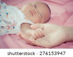 baby holding mother hand.... | Shutterstock . vector #276153947
