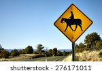 Horse And Rider Crossing Road...