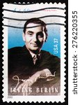 Small photo of USA - CIRCA 2002: a stamp printed in the USA shows Irving Berlin, Composer, and Score of God Bless America, circa 2002