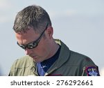 Small photo of CHINO/CALIFORNIA - MAY 3, 2015: Captain John Cummings F-22 Raptor Demo Pilot as he signs autographs at the Planes of Fame Airshow in Chino, California USA