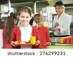 Stock photo female pupil with healthy lunch in school cafeteria 276299231