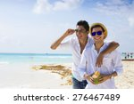 Small photo of Gay couple drinking a coconut in the Caribbean