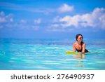 beautiful surfer woman surfing... | Shutterstock . vector #276490937