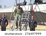 Small photo of CHINO/CALIFORNIA - MAY 3, 2015: Captain John Cummings F-22 Raptor Demo Pilot as he disembarks and approaches onlookers at the Planes of Fame Airshow in Chino, California USA
