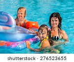 happy family  in swimming pool. ... | Shutterstock . vector #276523655