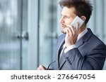 handsome businessman on the... | Shutterstock . vector #276647054