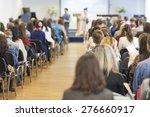 two hosts speaking in front of... | Shutterstock . vector #276660917