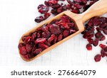 dry cranberry on white wooden... | Shutterstock . vector #276664079