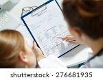 two female doctors examining... | Shutterstock . vector #276681935