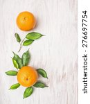 Two Orange Fruits With Green...