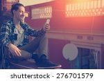 young and smiling man sitting... | Shutterstock . vector #276701579