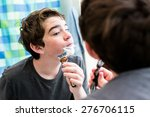 teenage boy getting ready for... | Shutterstock . vector #276706115