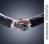 business human and robot hands... | Shutterstock . vector #276712721