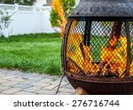 outdoor fire pit with roaring... | Shutterstock . vector #276716744