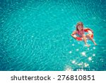 happy child playing in swimming ... | Shutterstock . vector #276810851