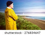fisherman in front of a coastal ... | Shutterstock . vector #276834647