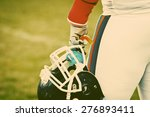 Small photo of american football game - retro style photograph