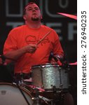 Small photo of DENVER MAY 11: Jean Gaster of Clutch performs May 11, 2001 at Red Rocks Amphitheater in Denver, CO.