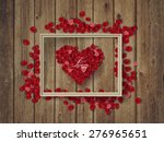 rose petals on wooden texture... | Shutterstock .eps vector #276965651