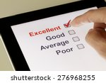 completing online survey on a... | Shutterstock . vector #276968255