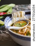 bowl of spicy asian soup with... | Shutterstock . vector #277016354
