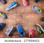 various running shoes laid on a ... | Shutterstock . vector #277054421