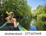 woman kayaker paddling down a...   Shutterstock . vector #277107449