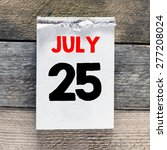 Calendar With 25 July On Woode...