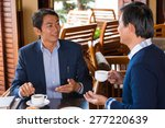 vietnamese colleagues talking... | Shutterstock . vector #277220639