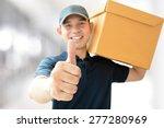 Deliveryman Carrying A Parcel...