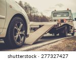 Loading broken car on a tow...