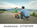 father and son on the bicycle... | Shutterstock . vector #277357499