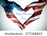 Stock photo the text happy memorial day written in the blank space of a heart sign made with the hands of a 277368815