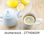 cup of lemon tea and lemon... | Shutterstock . vector #277406039