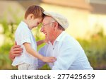 Portrait Of Happy Grandfather...