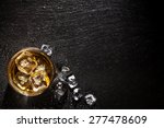 glass of whiskey with ice on... | Shutterstock . vector #277478609