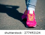 athletic pair of feet on a grass | Shutterstock . vector #277492124