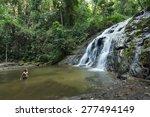 man standing by huge jungle... | Shutterstock . vector #277494149